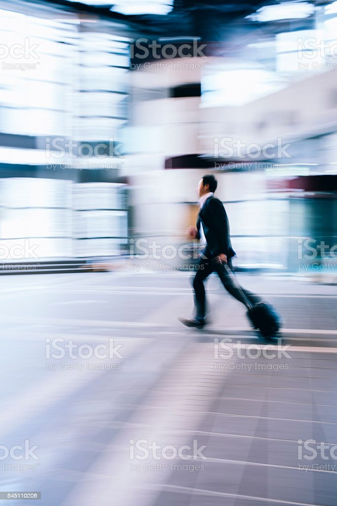 Businessman in a hurry stock photo