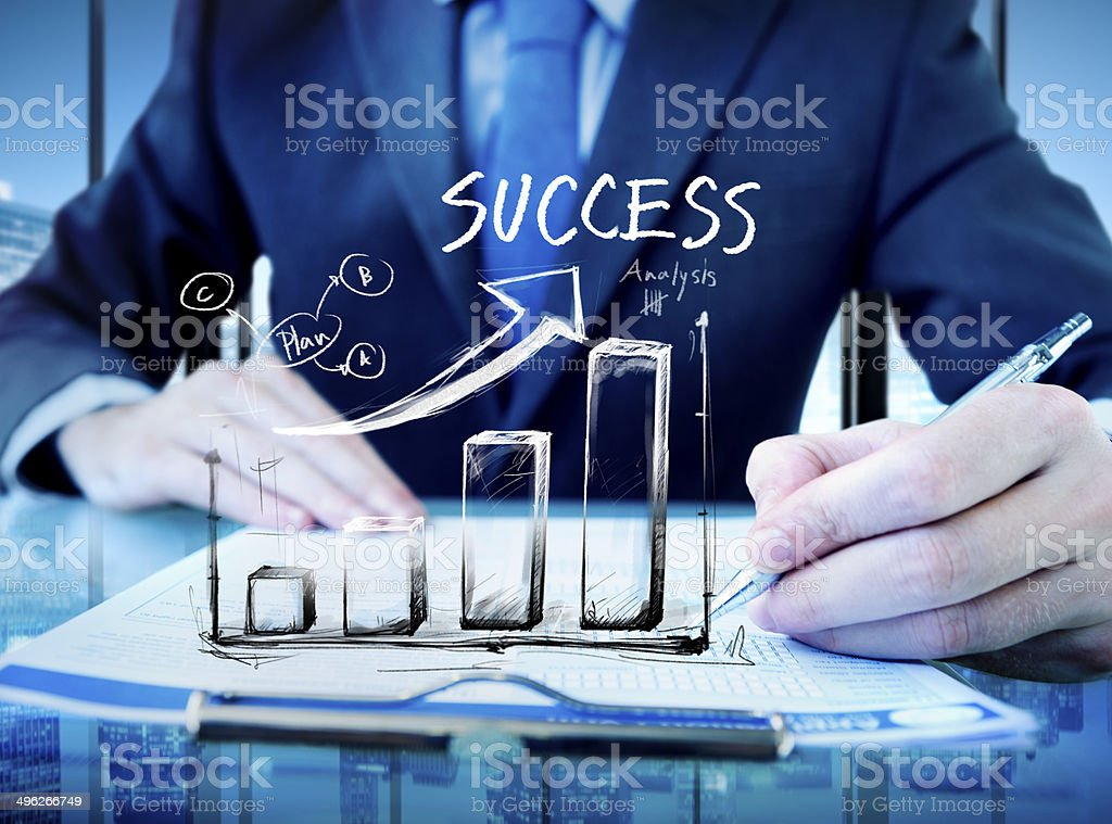 Businessman in a Office and Success Chart stock photo