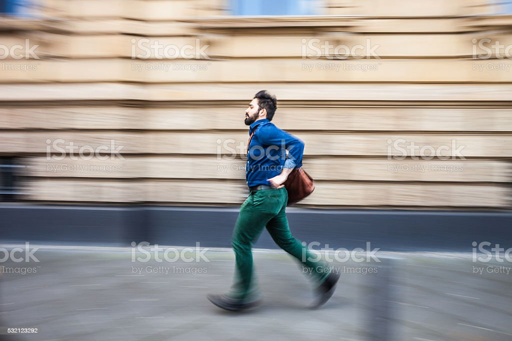 Businessman in a rush runs to the office stock photo