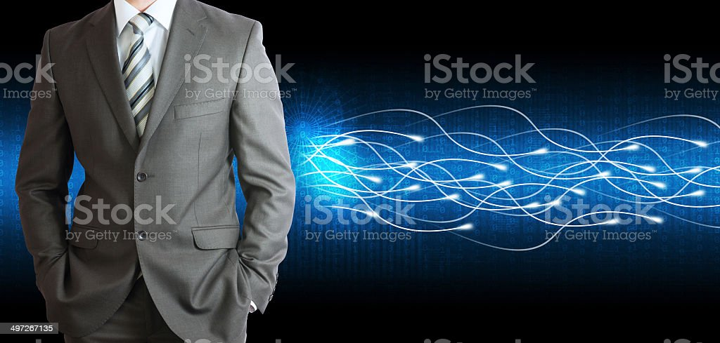 Businessman in a suit and glow rays stock photo