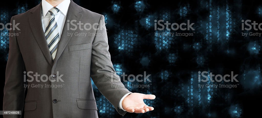Businessman in a suit. Blue glowing figures stock photo