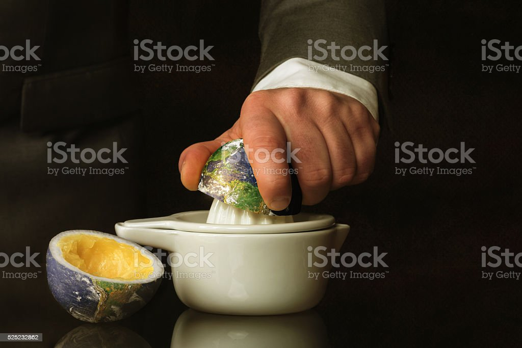 Businessman in a suit presses the Earth stock photo