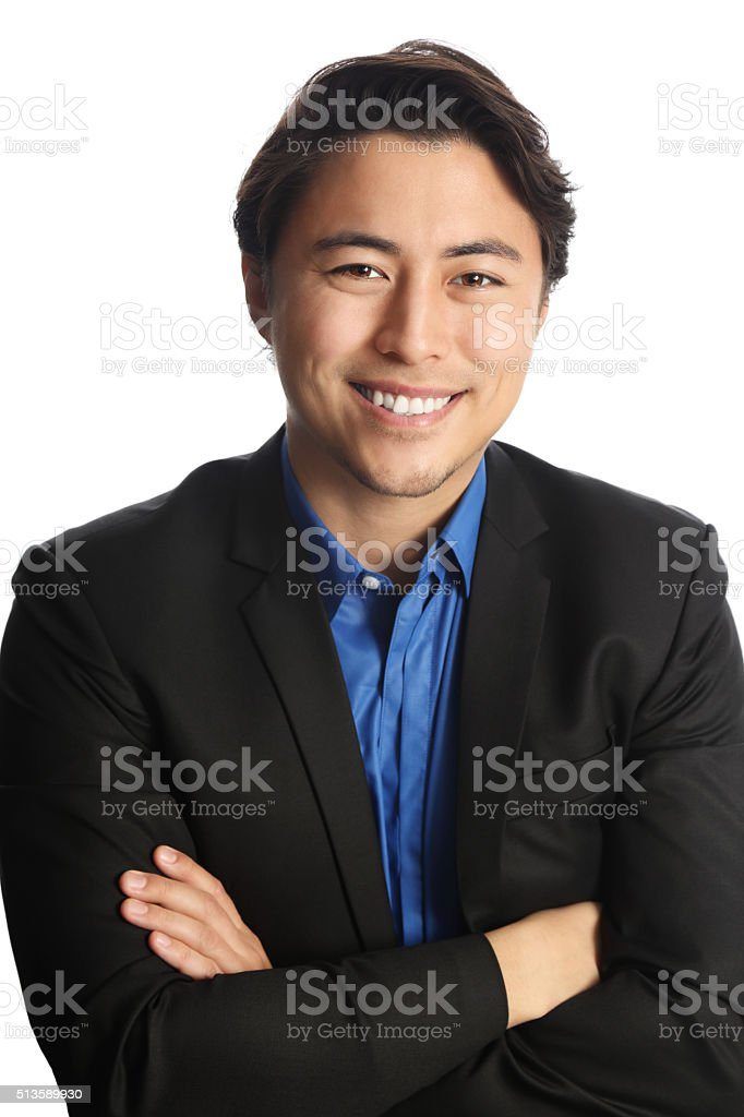 Businessman in a suit sitting down stock photo