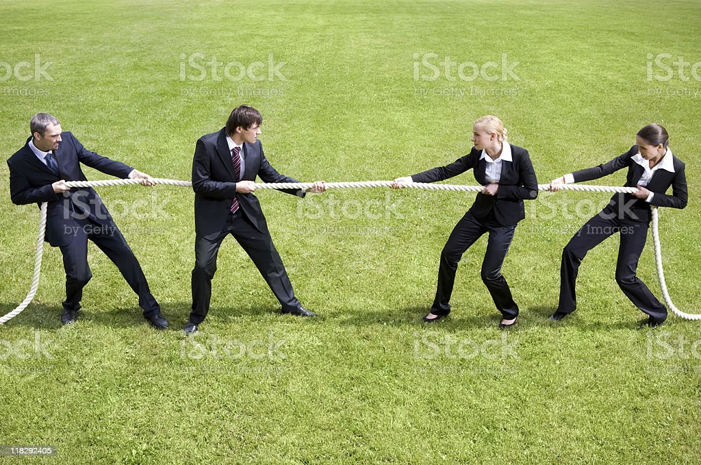 Businessman in a tug of war competition royalty-free stock photo