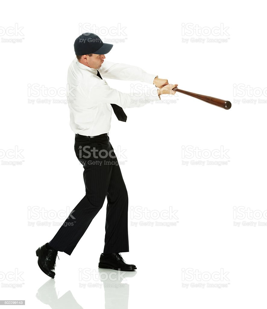 Businessman in action with baseball bat royalty-free stock photo