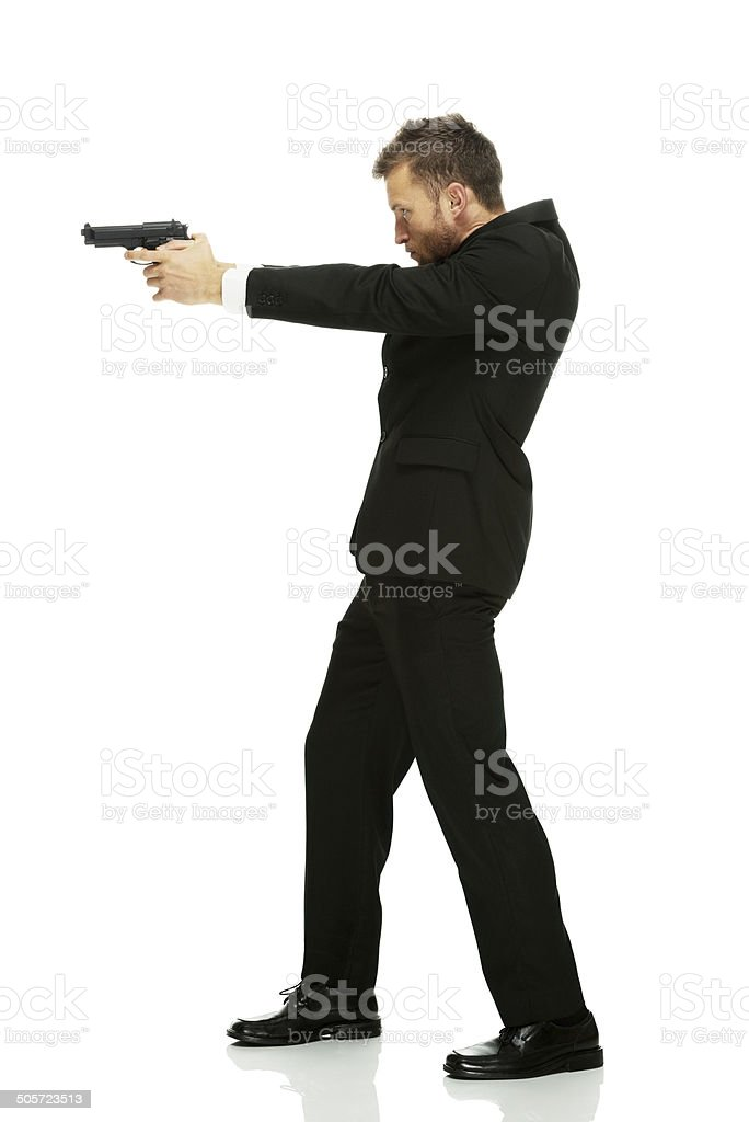 Businessman in action with gun royalty-free stock photo