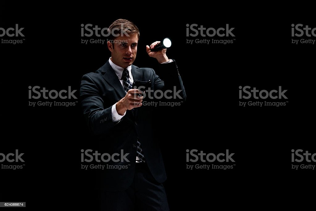 Businessman in action with gun stock photo