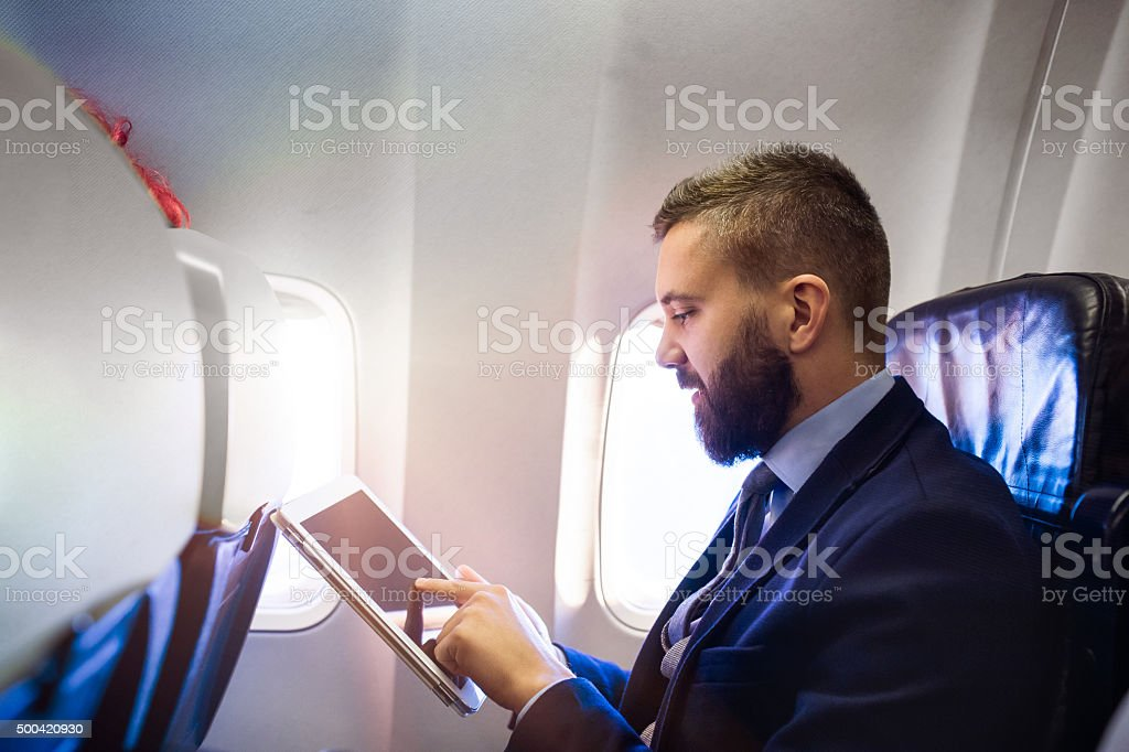 Businessman in airplane stock photo