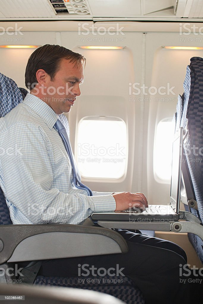 Businessman in an airplane royalty-free stock photo