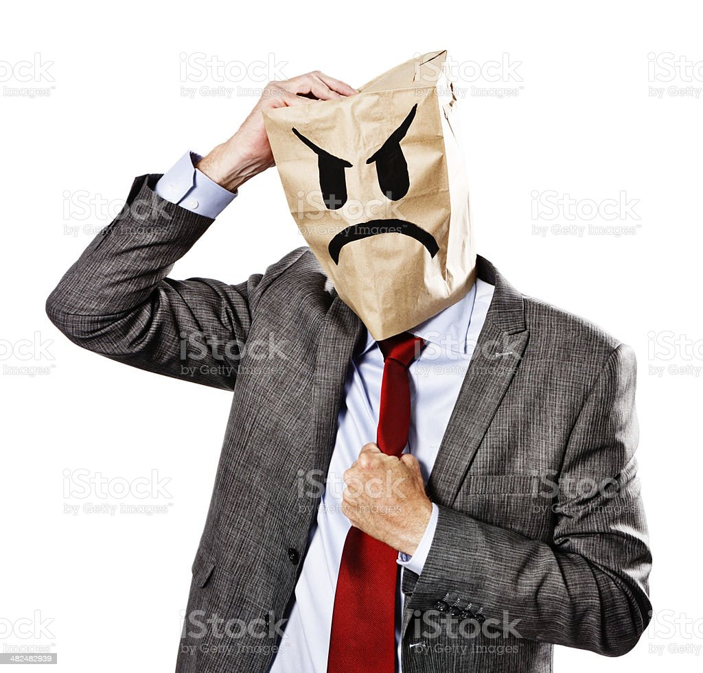 Businessman in angry paper-bag mask about to lose temper stock photo