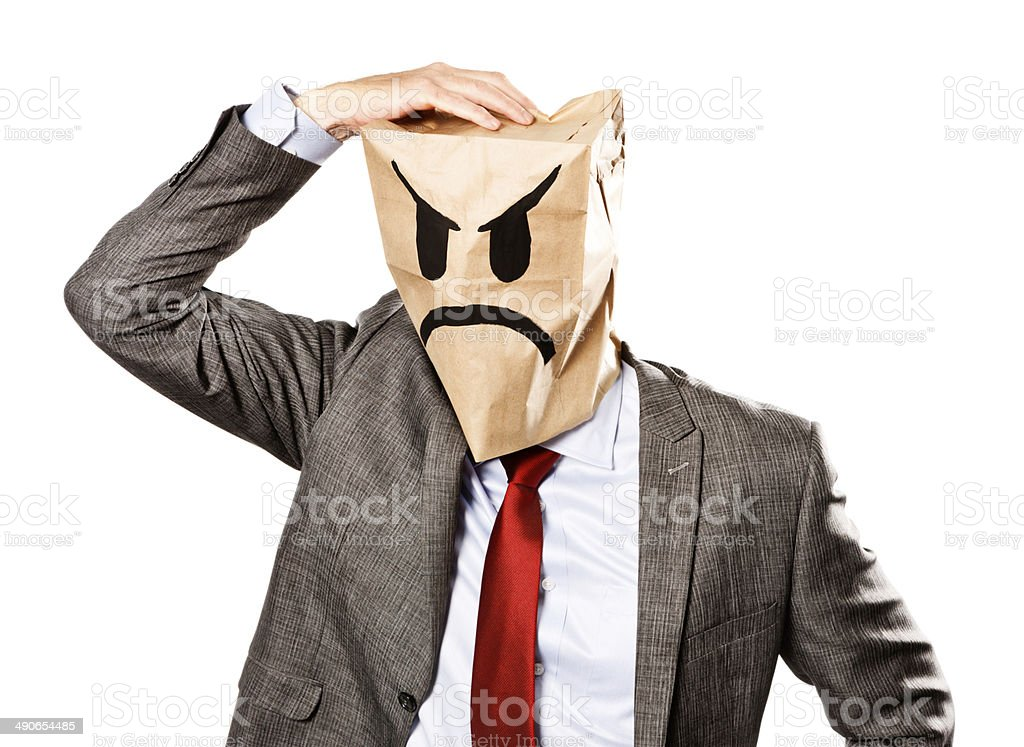 Businessman in angry paper-bag mask loses his temper stock photo