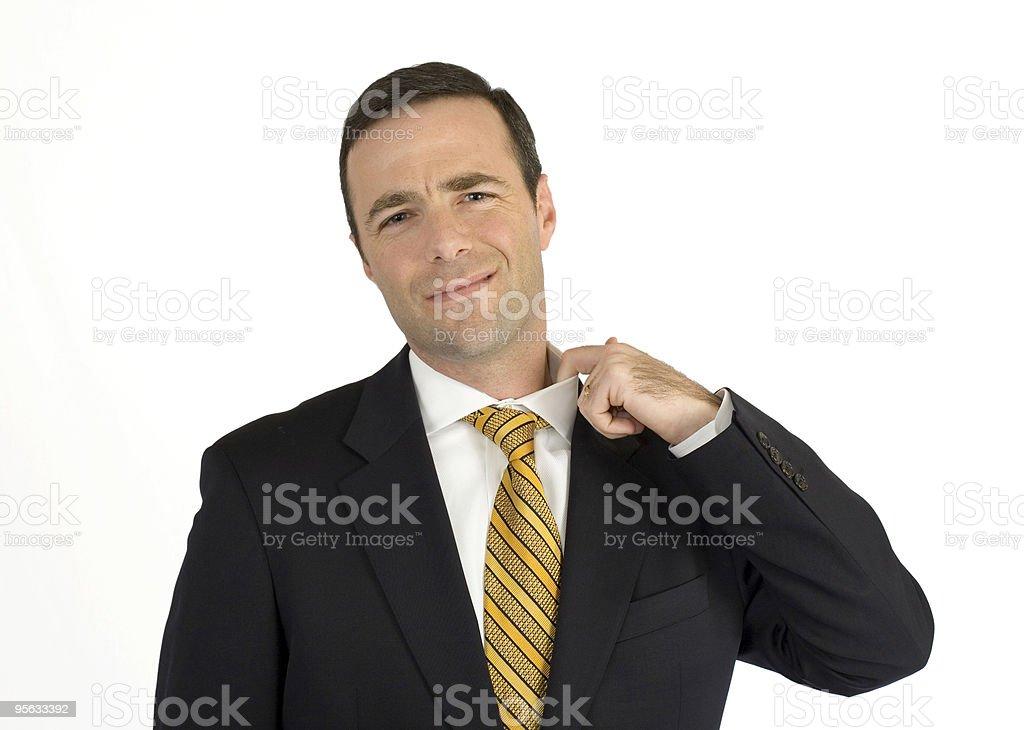 Businessman in black suit nervously adjusting collar stock photo