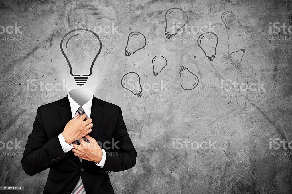 Businessman in black suit with light bulb instead head stock photo