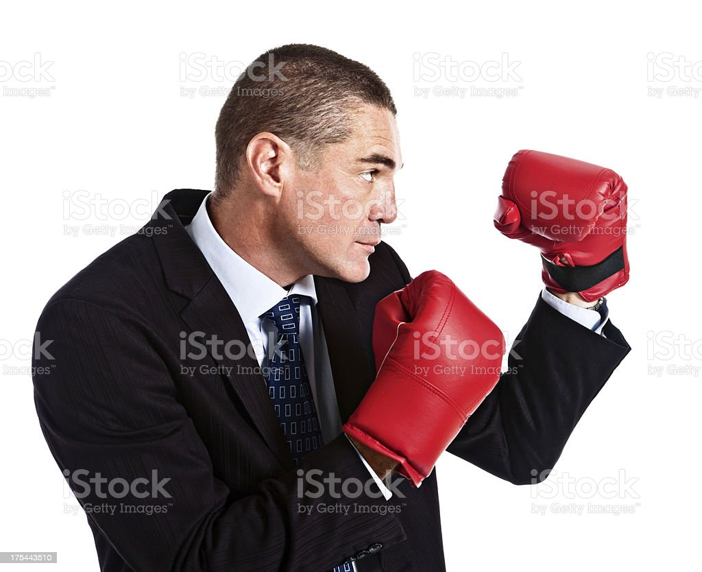 Businessman in boxing gloves is ready for anything royalty-free stock photo