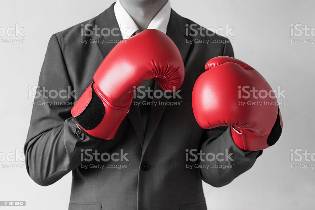 Businessman in boxing gloves isolated on white background stock photo