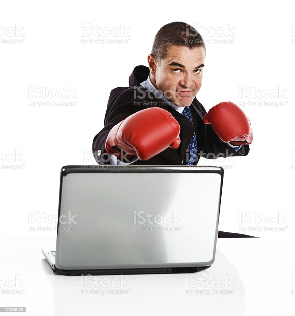 Businessman in boxing gloves with laptop; his data is safe! royalty-free stock photo