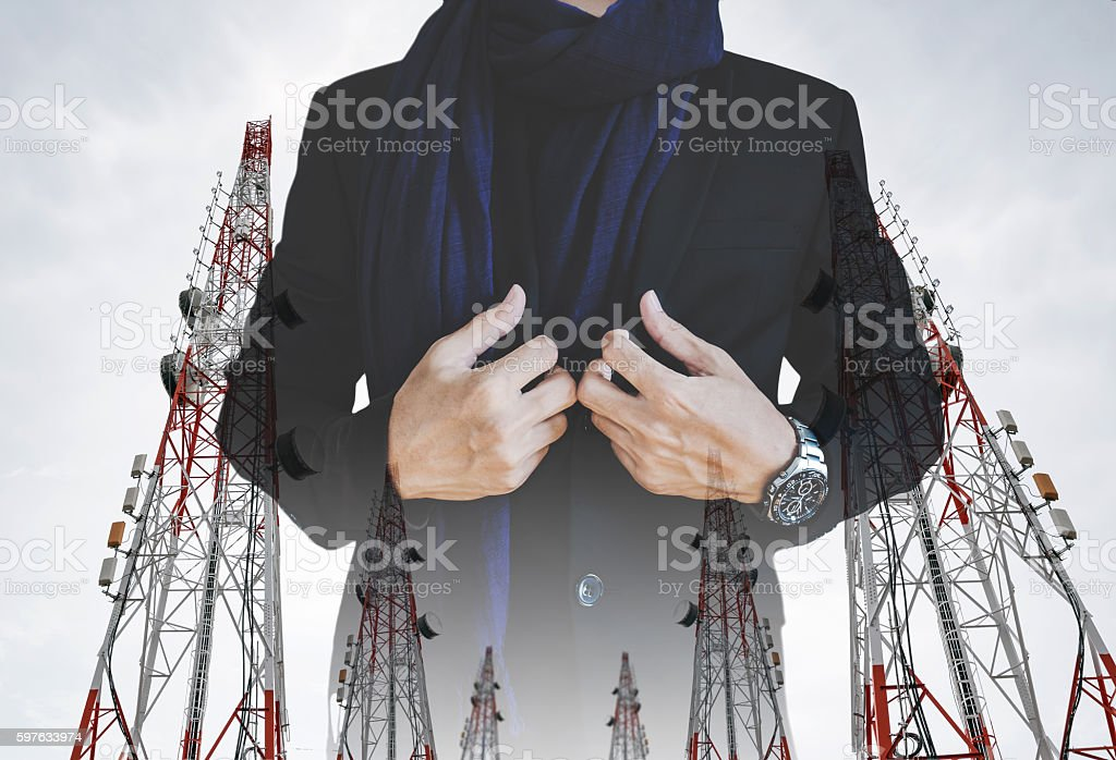 Businessman in casual suit with multiple exposure Telecommunication towers stock photo