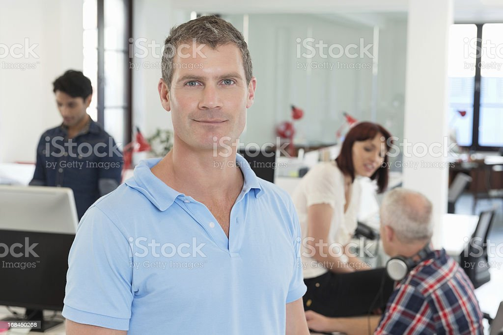 Businessman In Casuals With Colleagues royalty-free stock photo