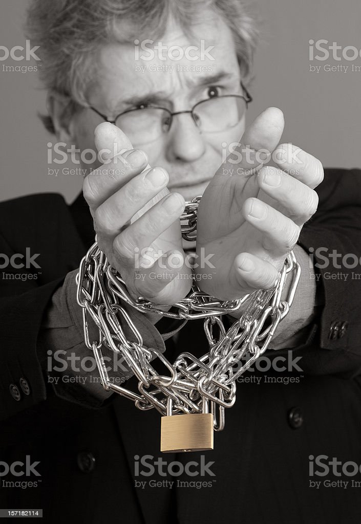 Businessman in Chains b/w stock photo