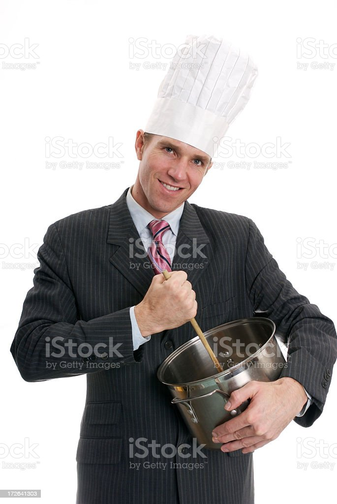 Businessman in Chef Hat Cooks with Pan White Background stock photo