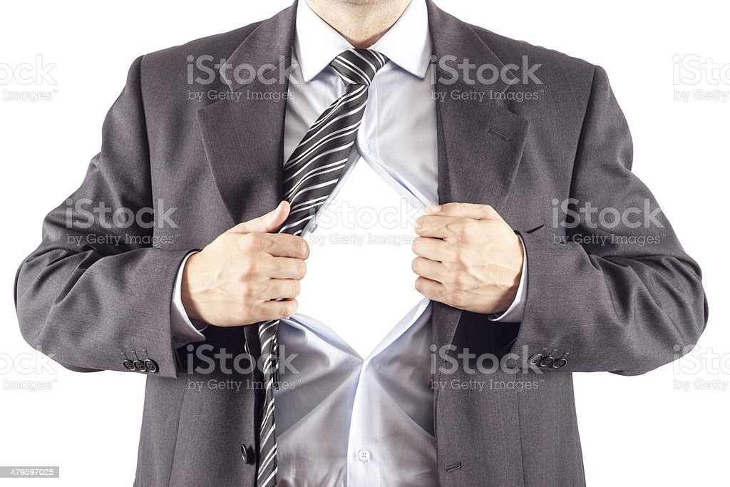 Businessman in classic superman pose tearing his shirt open stock photo