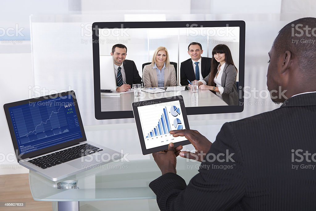 Businessman In Conference Analyzing Graph royalty-free stock photo