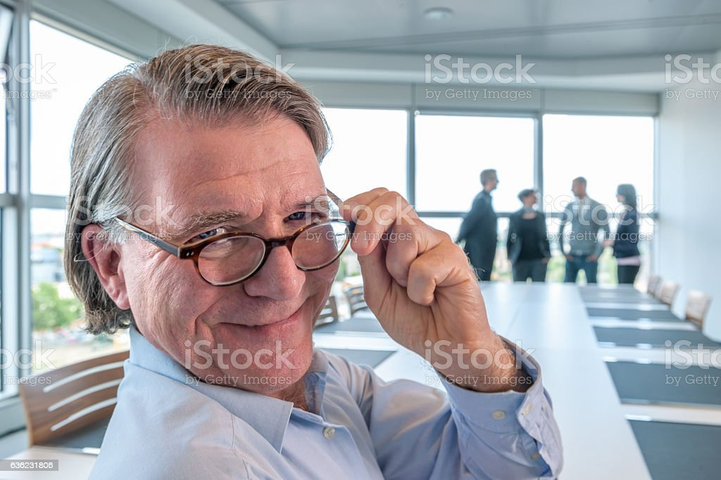 businessman in contemporary board room stock photo