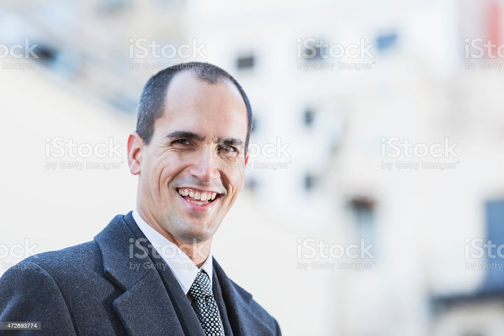 Businessman in dark gray suit and wool coat stock photo
