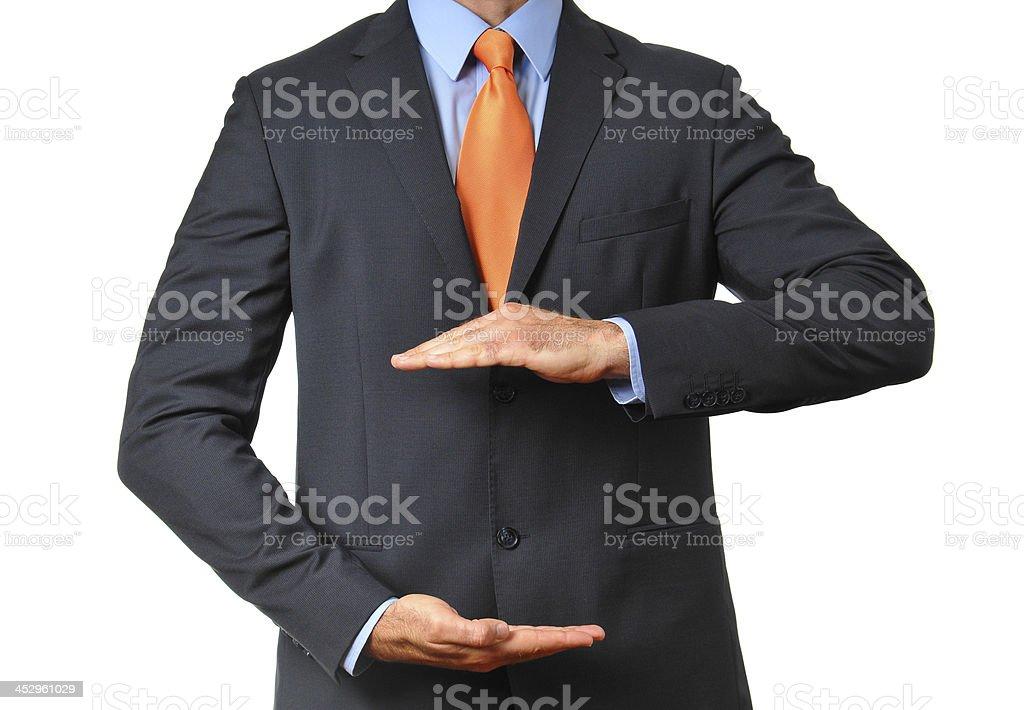 Businessman in dark suit with necktie gesturing with hands royalty-free stock photo