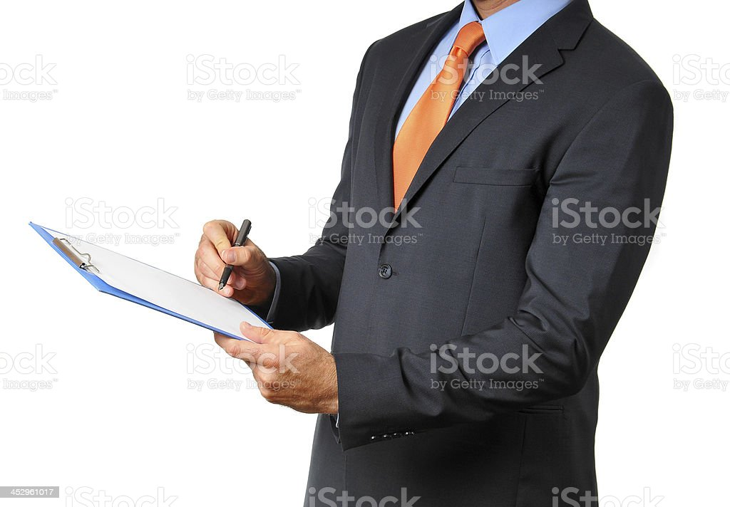 Businessman in dark suit with necktie signing financial document royalty-free stock photo
