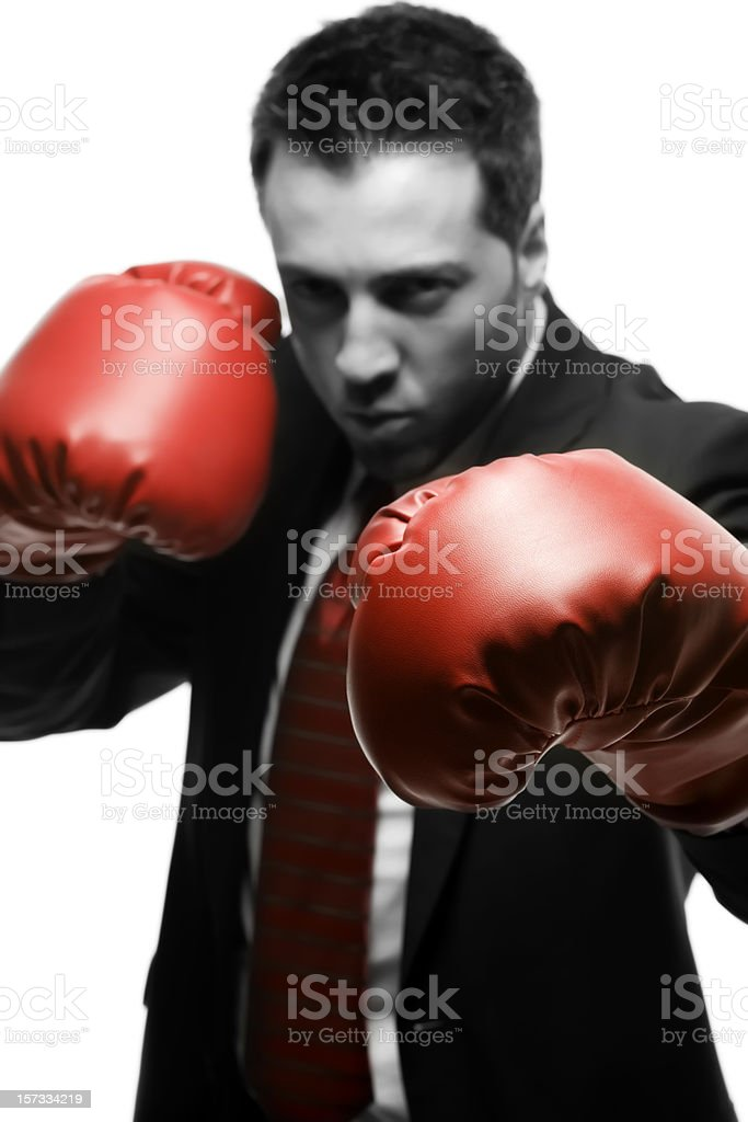 Businessman in dark suit with red Boxing gloves. royalty-free stock photo