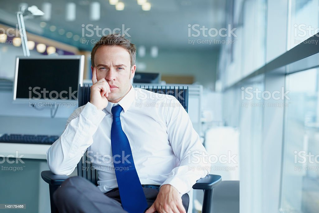 Businessman in deep thought stock photo