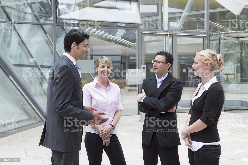 Businessman in discussion with group of business people royalty-free stock photo