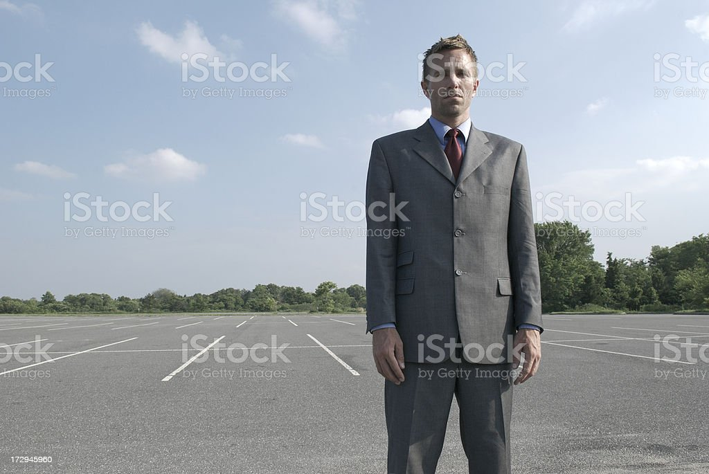 Businessman in Empty Parking Lot royalty-free stock photo