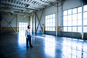 Businessman in Empty Warehouse