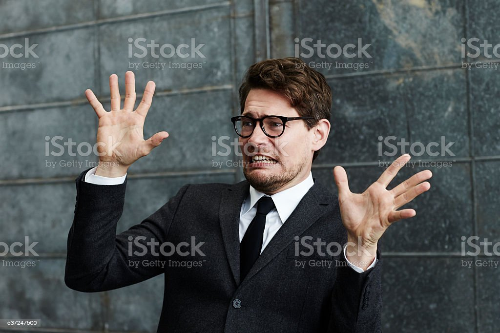 Businessman in fear stock photo