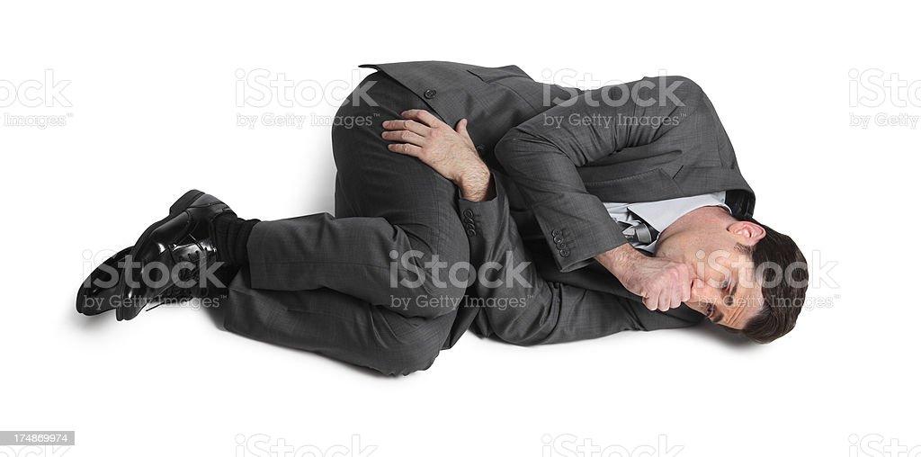 Businessman In Fetal Position stock photo