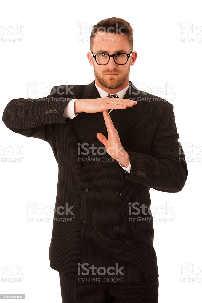 Businessman in formal suit gesturing time out isolated. stock photo