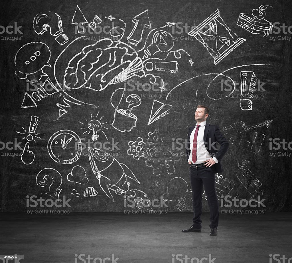businessman in formal suit is thinking about business development stock photo