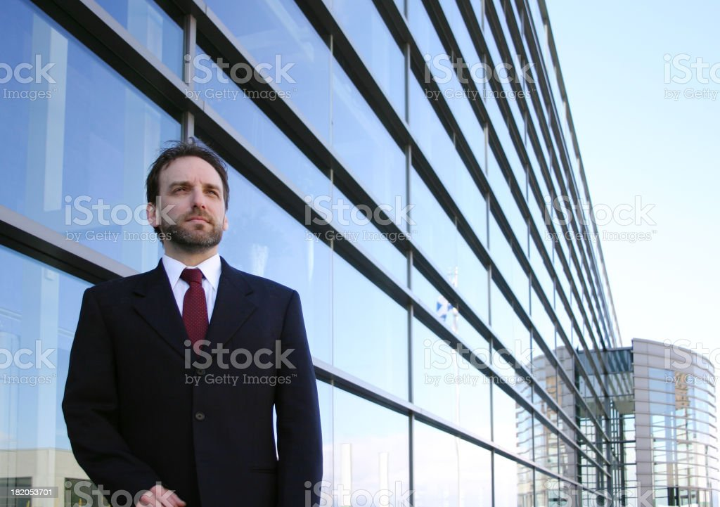 Businessman in front of an office royalty-free stock photo