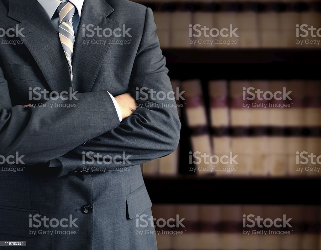 Businessman in front of books stock photo