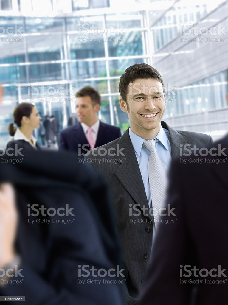 Businessman in front of office building royalty-free stock photo