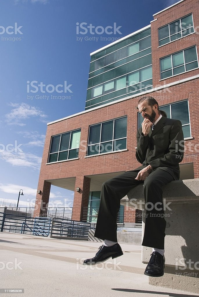 Businessman in front of the office building stock photo