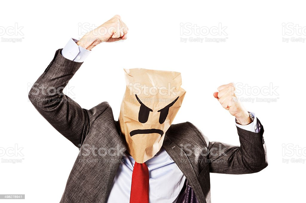 Businessman in frowning paper-bag mask shakes fists furiously stock photo
