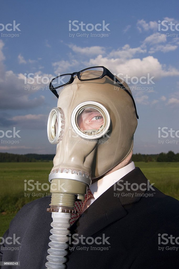 Businessman in gas mask stock photo