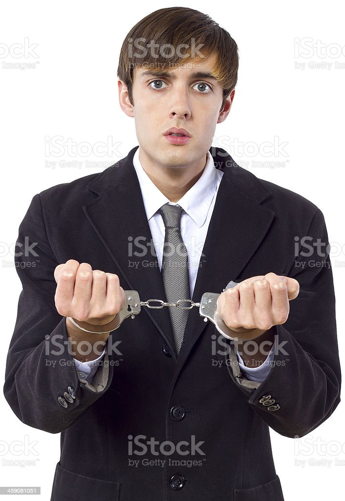 Businessman in Handcuffs Because of Illegal White Collar Crime royalty-free stock photo