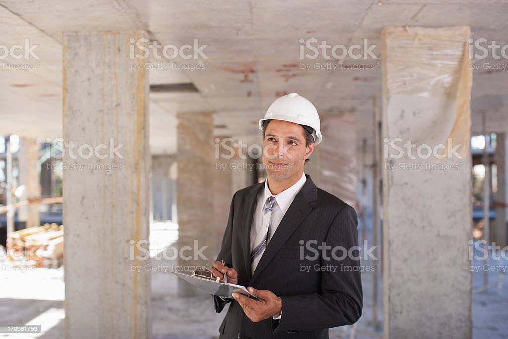 Businessman in hard-hat on construction site royalty-free stock photo