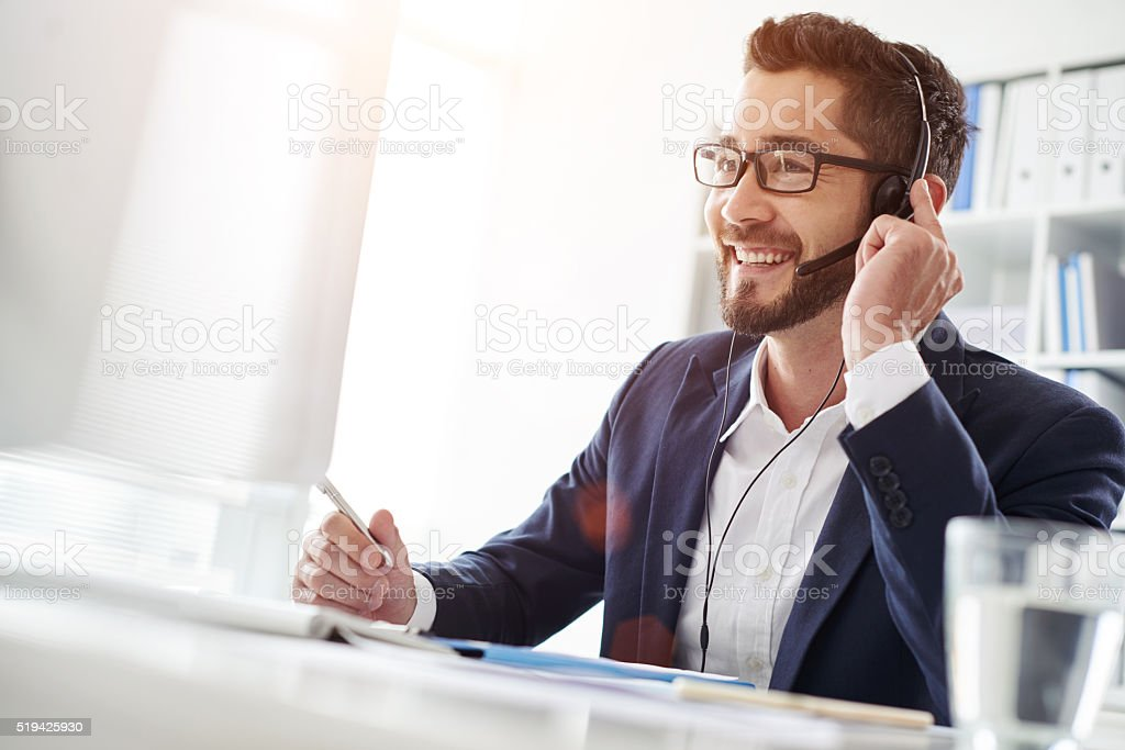 Businessman in headset stock photo
