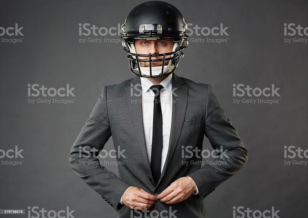 Businessman in helmet stock photo