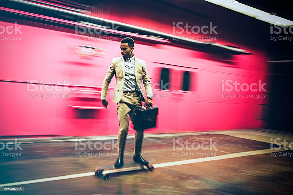 businessman in hurry on longboard stock photo